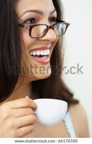 Close up of woman in glasses drinking coffee