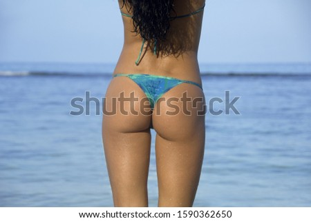 Close-up of woman in thong bikini