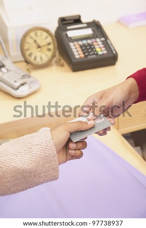 Close up of woman making credit card purchase