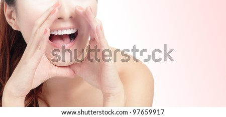 close up of woman mouth deliver message by whispering with pink background, model is a asian beauty