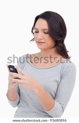 Close up of woman reading text message against a white background
