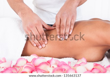 Close-up Of Woman Receiving Massage In Spa