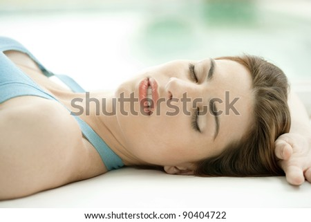 Close up of woman relaxing in health spa.