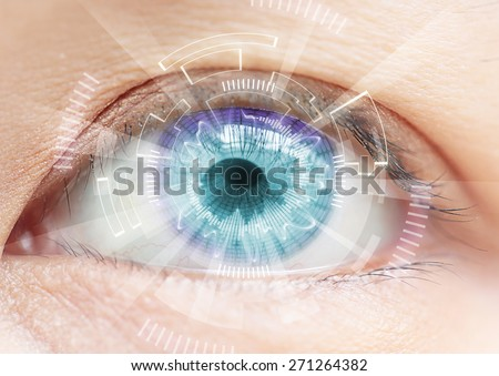 Close-up of woman\'s blue eye. High Technologies in the futuristic. : contact lens