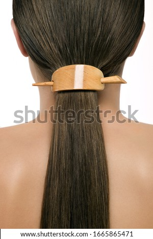 Close up of woman's hair in ponytail with hair accessory