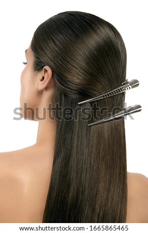 Close up of woman's hair with clips