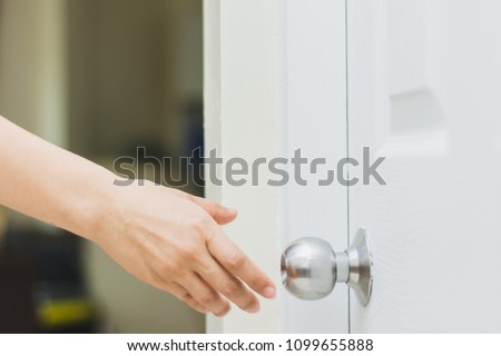 Close Up Of Womanu0027s Hand Reaching To Door Knob, Opening The Door #1099655888