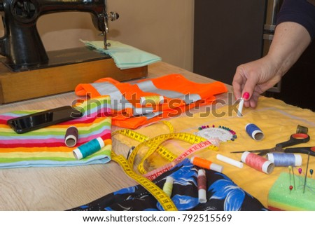 Close-up of woman's hand stitching quilting. Tailor Woman working in his tailor shop, Tailoring. Garment industry, tailoring concept #792515569