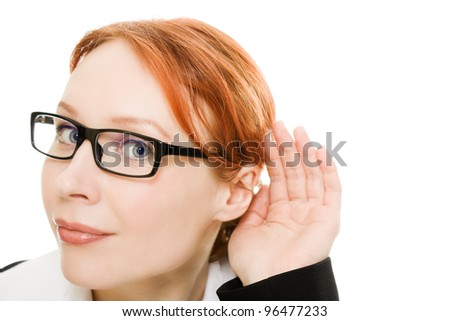Close up of woman's hand to his ear on a white background.