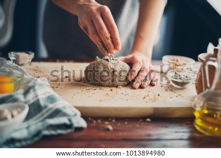 Close up of woman`s hands making a bread. #1013894980