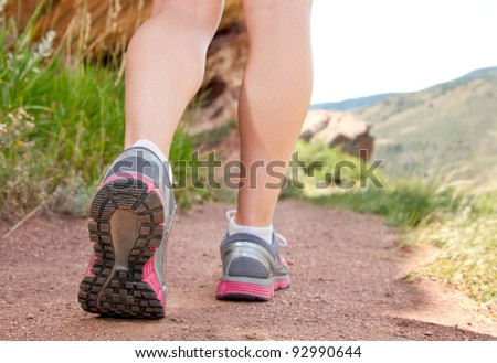Close up of woman's shoes hiking in the mountains