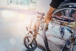Close up of woman sitting and use a wheelchair at the hospital with copy space