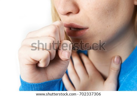 Close Up Of Woman Suffering With Cough