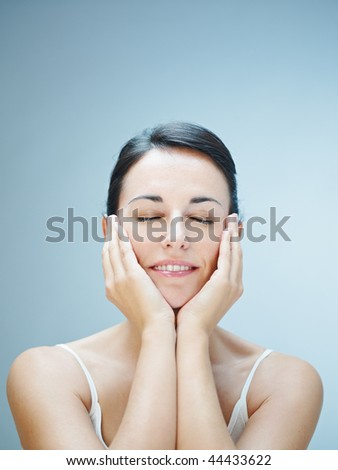 close up of woman touching chins. Copy space