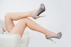 Close-up of woman trying high heels