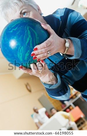 Close up of woman with bowling ball