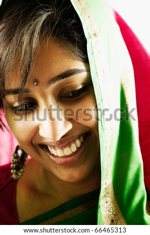 Close up of woman with jewel in forehead