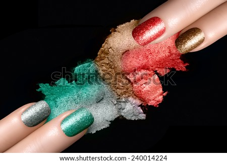 Close Up of Women Hands with Painted Nails and Coordinating Mineral Eye Shadows Swatches in Festive Colors on Black Background