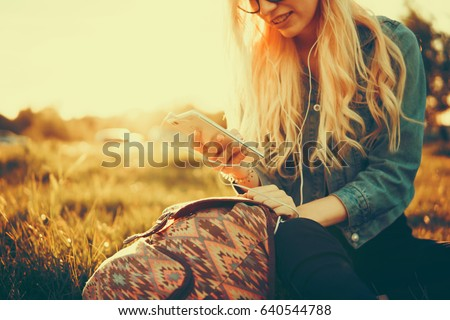 Close up of women's hands holding cell telephone with blank copy space scree for your advertising text message or promotional content, hipster girl watching video on mobile phone during coffee break #640544788