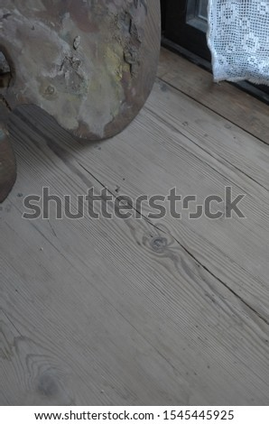close up of wood and artist's palette and a corner of curtain