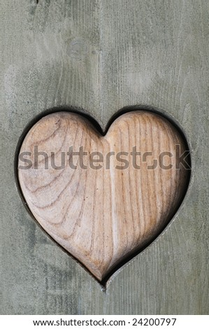 close up of wooden heart in wooden door