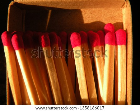 Close-up of wooden matches in match box. #1358166017