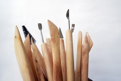 Close-up of wooden modeling, needle and sgraffito tools for ceramic art and pottery. Isolated on white with copy space.