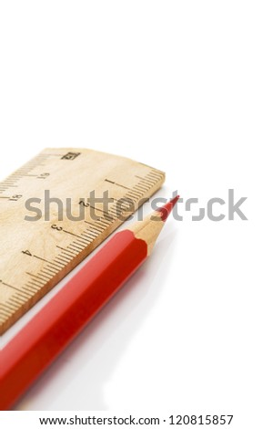 Close-up of wooden ruler and red pencil