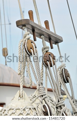 Close-up of wooden tools and ropes of a boat - stock photo