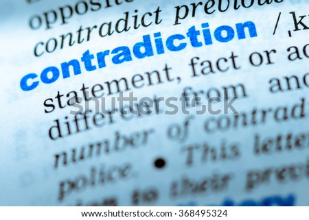 Close-up of word in English dictionary  Contradiction, definition