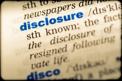 Close-up of word in English dictionary. Disclosure, definition and transcription