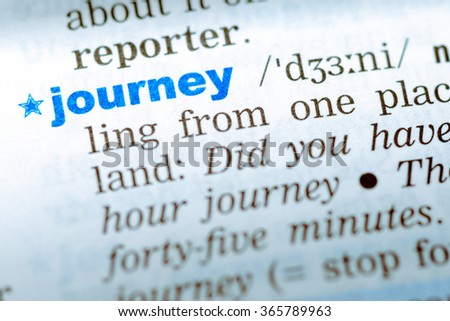 Close-up of word in English dictionary  Journey, definition and