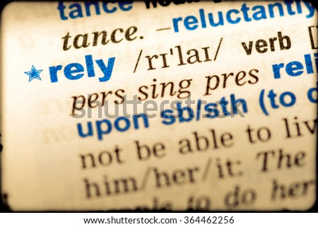 Close-up of word in English dictionary  Rely, definition and