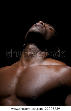 Close up of  worked pectorals of an African American Young.