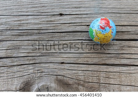 Close up of world globe - top view - travel destination and love different cultures concept - place for text