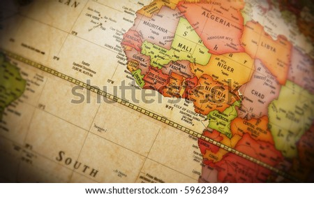 Close up of world map with detail of African continent. Focus centered on Golf of Guinea and Atlantic Ocean. Shallow depth of field and vignetting