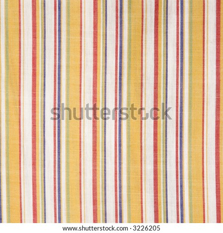 Close-up of woven vintage fabric with colorful stripes on cotton.