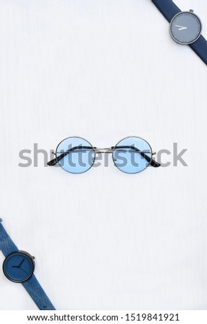 close up of wristwatches with sunglasses isolated on white background #1519841921