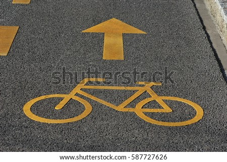Close Up Of Yellow Bicycle Symbol On The Car Road Road Sign For