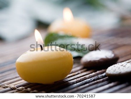 Close up of yellow candles with shallow focus