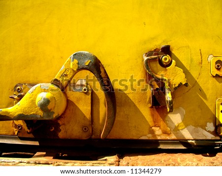 Close up of Yellow latching mechanism for a van door