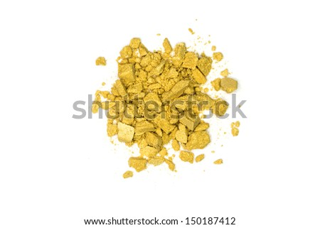 Close up of yellow make up powder and crushed eyeshadow