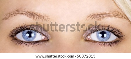 Close-up of young blond woman with amazing blue eyes