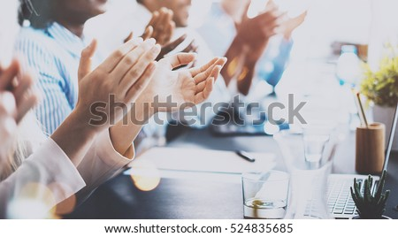 Close up of young business partners applauding to reporter after listening report at seminar. Professional education, work meeting, presentation or coaching concept.Horizontal,blurred background #524835685