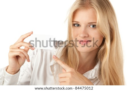 Close up of young business woman pointing to the blank card she is holding, isolated on white background