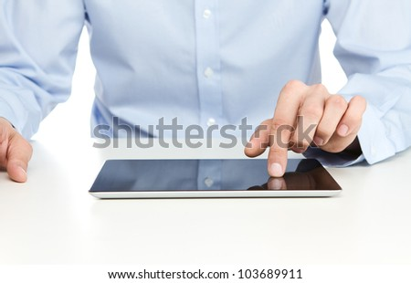 Close up of young businessman using digital tablet