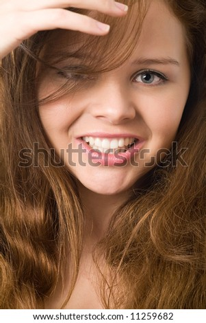 close-up of young girl's face with beautiful smile