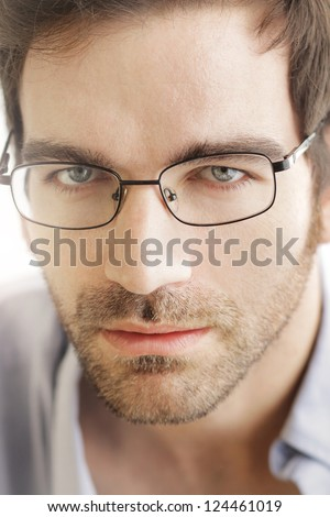 Close-up of young handsome man wearing fashion eyeglasses