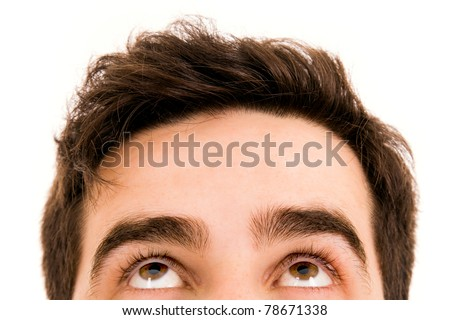 Close-up of Young man looking up - stock photo