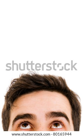 Close-up of young man looking up against white background